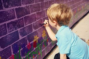 SCC Walk 2014 - Boy writing on Wall