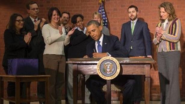 2014 Jan - Obama signing Omnibus Bill