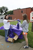 General Page 2014 - Volunteer handing out t-shirt