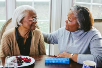 Caregiver woman at table