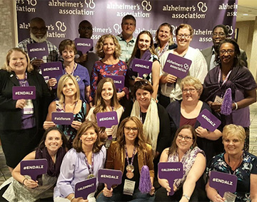 Advocates with ENDALZ signs