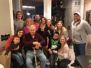 Larry (maroon shirt) with his wife, kids, and grandkids.